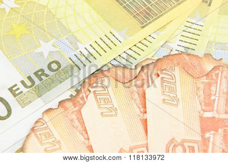 Burnt Russian Notes And Euros Background