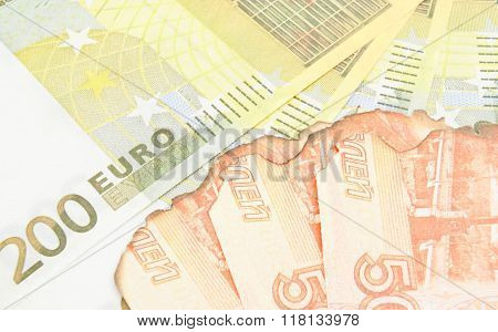 Burnt Russian Banknotes And Euros Background