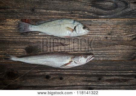 Raw Fish Over Wooden Background, Top View