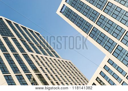 Modern High Rise Glass Building And Blue Sky