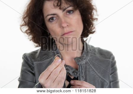 Sad Woman Is Taking Off And Giving Her Wedding Ring