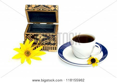 The Cup Of Coffee And Casket Decorated With A Yellow Flower, Isolate