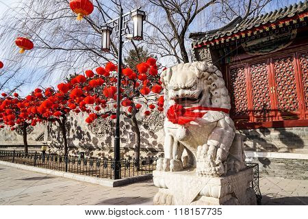 A Guardian Lion in a Historic Traditional Garden of Beijing, China in winter, during Chinese New Yea