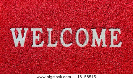 Welcome white mat isolated on red background