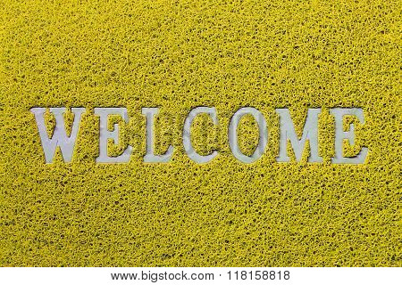 Welcome white mat isolated on yellow background