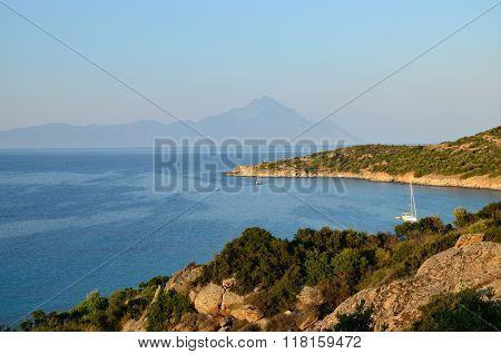 Greek Bay And Athos Mountain In Sunset