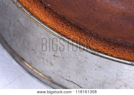 Close up of metal springform with fresh cake