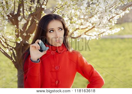 Upset  Woman with Inhaler  in Spring Blooming Decor