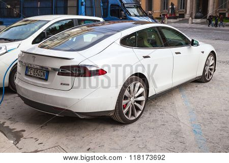 White Tesla Model S Car On Roadside In The City