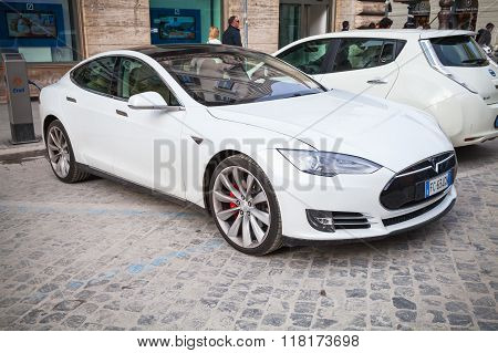 White Tesla Model S Car Parked On Roadside In The City