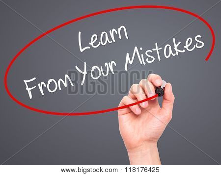 Man Hand Writing Learn From Your Mistakes  With Black Marker On Visual Screen