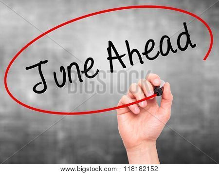 Man Hand Writing June Ahead With Black Marker On Visual Screen