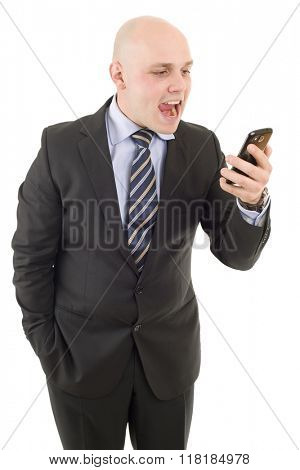 Angry businessman yelling into a cellphone. Isolated on white background