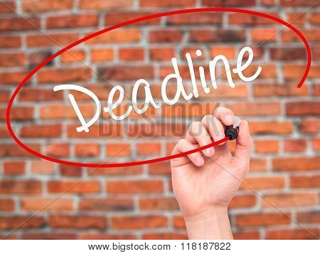 Man Hand Writing Deadline With Black Marker On Visual Screen