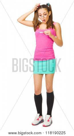 Worried schoolgirl with pregnansy test isolated