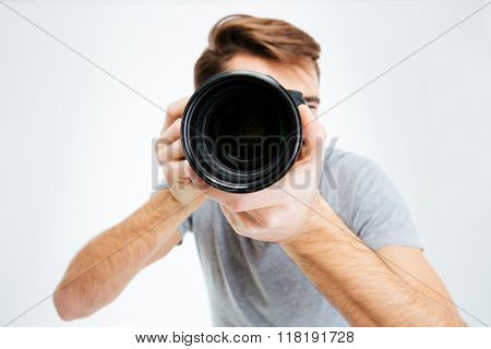 Closeup portrait of photographer making shot on photo camera