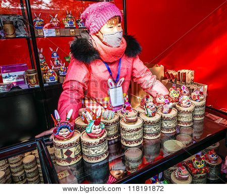 A female vendor of traditional Chinese handcraft of clay sculpture, on Spring Festival Temple Fair,