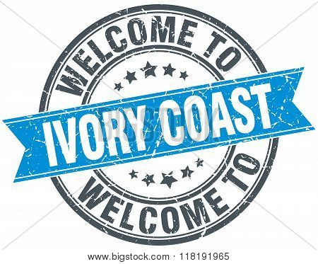 welcome to Ivory Coast blue round vintage stamp