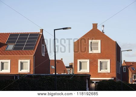 Roof With Solar Panels In A Residential District