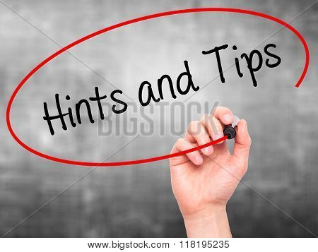 Man Hand Writing Hints And Tips With Black Marker On Visual Screen
