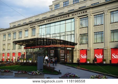 MOSCOW, RUSSIA - JULY 2, 2014: People entering into the department store TSUM from the Kuznetsky Most street during seasonal sale. The building was erected in 1908 by design of Roman Klein