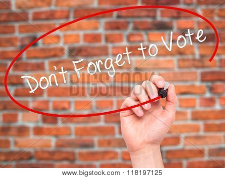Man Hand Writing Don't Forget To Vote With Black Marker On Visual Screen