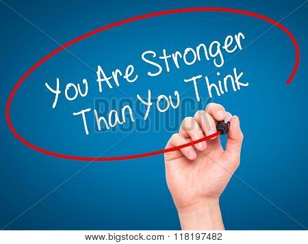 Man Hand Writing You Are Stronger Than You Think With Black Marker On Visual Screen