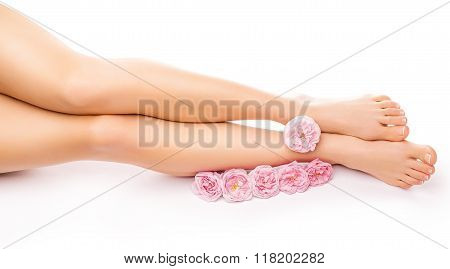Relaxing pedicure with a pink rose flower