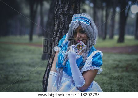 imagination, alice in wonderland, girl in a forest with smoke colore and playing cards