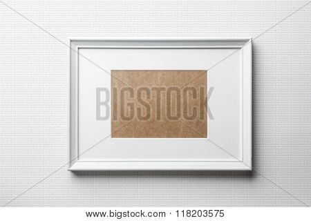 White wood frame on white bricks background