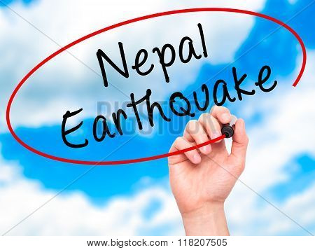 Man Hand Writing Nepal Earthquake With Black Marker On Visual Screen