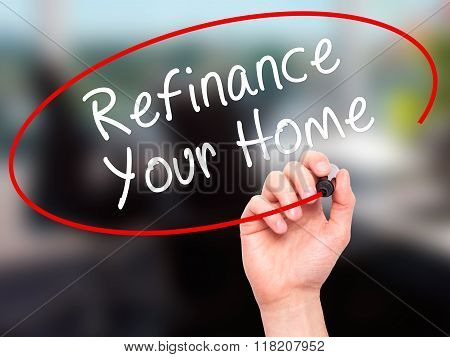 Man Hand Writing Refinance Your Home With Black Marker On Visual Screen