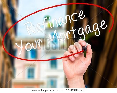 Man Hand Writing Refinance Your Mortgage With Black Marker On Visual Screen