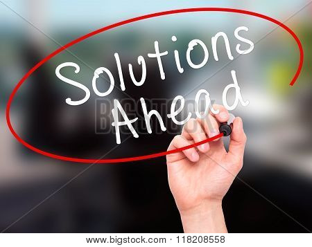 Man Hand Writing Solutions Ahead With Black Marker On Visual Screen