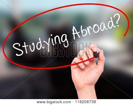 Man Hand Writing Studying Abroad? Black Marker On Visual Screen