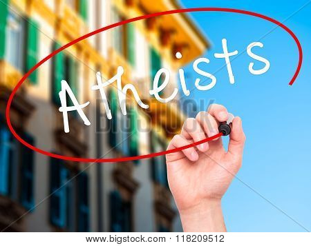 Man Hand Writing Atheists With Black Marker On Visual Screen