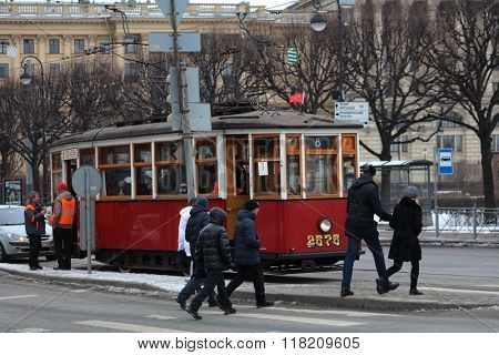 ST. PETERSBURG, RUSSIA - FEBRUARY 6, 2016: Old styled tram at the crossroad. The museum of urban electric transport organize trips in the retro styled trams of 1930s