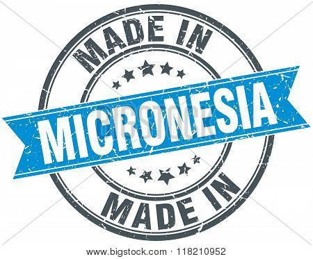 made in Micronesia blue round vintage stamp