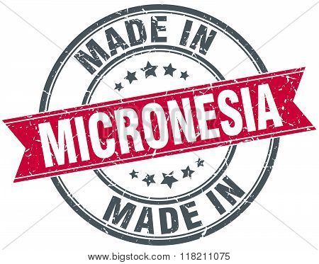 made in Micronesia red round vintage stamp