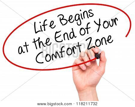 Man Hand Writing Life Begins At The End Of Your Comfort Zone With Black Marker On Visual Screen