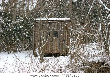 Old chicken coop in snow