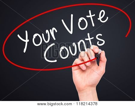 Man Hand Writing Your Vote Counts With Black Marker On Visual Screen