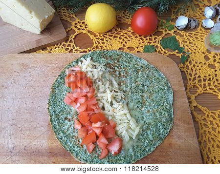 Nettles Omelette Roll Stuffed With Tomato And Cheese cooking