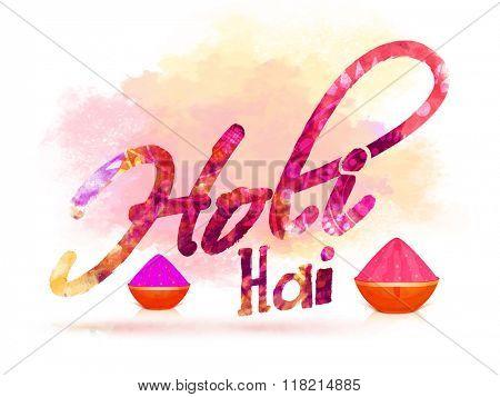 Creative colourful Hindi text Holi Hai (Its Holi) with dry colours in bowls for Indian Festival, Happy Holi celebration.