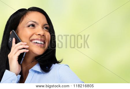 Asian business woman calling by cellular.