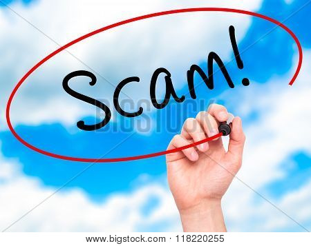Man Hand Writing  Scam! With Black Marker On Visual Screen