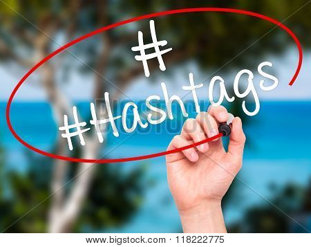 Man Hand Writing #hashtags With Black Marker On Visual Screen
