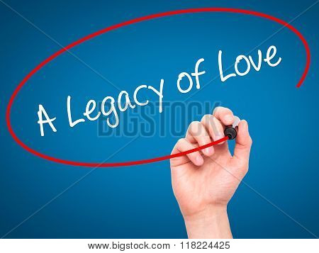 Man Hand Writing A Legacy Of Love With Black Marker On Visual Screen