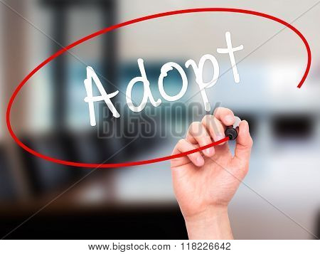Man Hand Writing Adopt  With Black Marker On Visual Screen