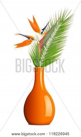Strelitzia reginae, bird of paradise flower with palm leaf in vase